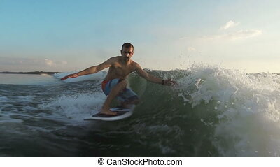 Active Vacations - Slow motion of rider wake surfing in...