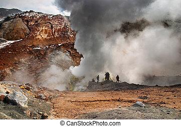 People inside active volcanic crater, Mutnovsky volcano, Kamchatka
