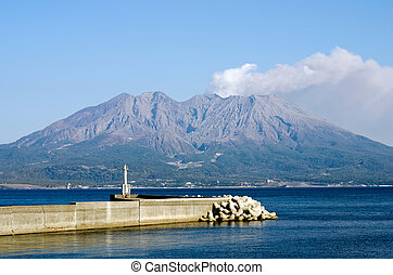 Active volcano with jetty - Active volcano and volcanic...