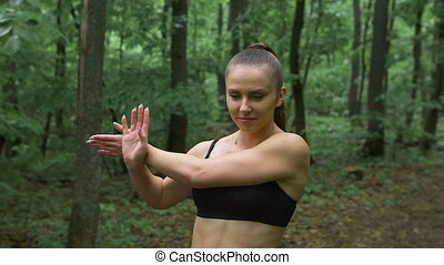 Active weekend. Young attractive brunetka with long hair, doing exercises to improve tone.