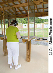 Active Woman At The Gun Range