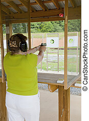 Active Woman At The Gun Range - Off duty officer spending...