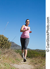 Active woman jogging in the countryside