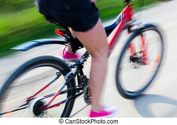 Active woman on a bike