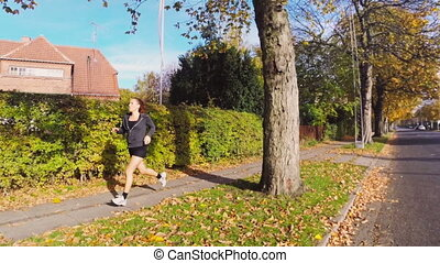 Active Woman Running on the Street