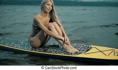 Active Woman Stand Up Paddle Boarding On Summer evening 4k