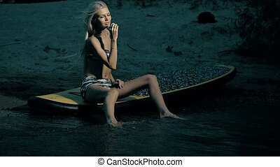 Active Woman Stand Up Paddle Boarding On Summer evening