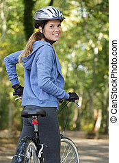 active woman with bike outdoor