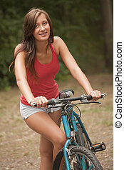 active woman with bike