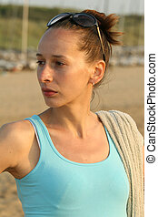 Active woman with towel by sunset