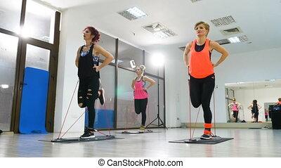 Active women doing fitness session for legs