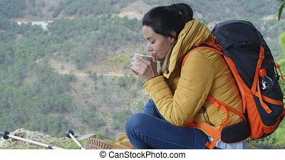 Active young female backpacker