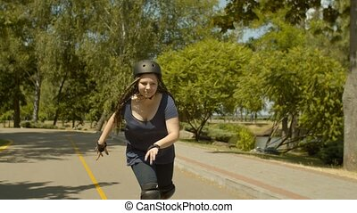 Active young female rollerblading at speed in park -...
