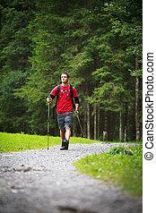 active young man nordic walking