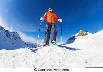 Active young man skiing view from below in Sochi