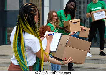 active young people enjoys volunteering at food and clothes bank