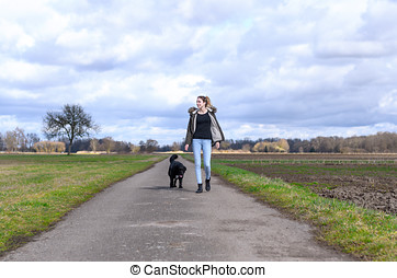 Active young woman jogging with her pet dog