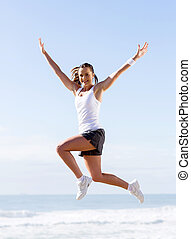 active young woman jumping