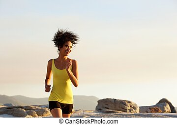 Active young woman running outdoors