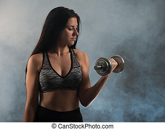 Active young woman workout with dumbbells
