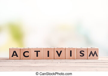 Activism word on wooden cubes on a table