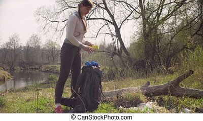 Activist pulls out garbage bag from backpack - Green...