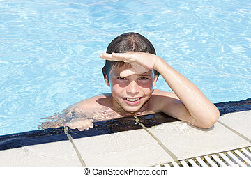 Activities on the pool. Cute boy swimming and playing in water in swimming pool
