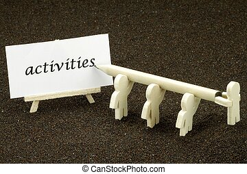 Activities - Wood males jointly write the word activities