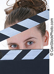 woman actor with clapper board