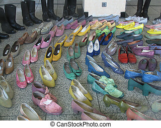 A row of actors shoes looking like walking...