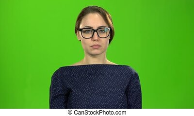 Actress looks up and starts smiling. Green screen - Actress...