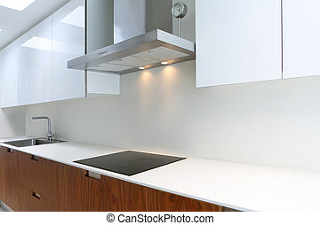 Actual modern kitchen in white and walnut wood interior house