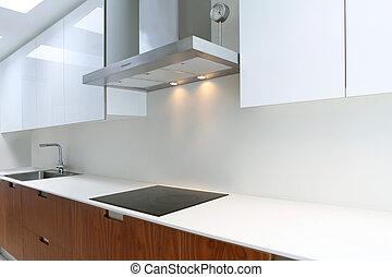 Actual modern kitchen in white and walnut wood interior...