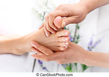 Acupressure, foot massage - Woman in a beauty salon for ...