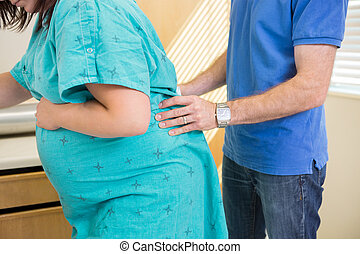 Acupressure Pain Relief During Labour - Husband providing...