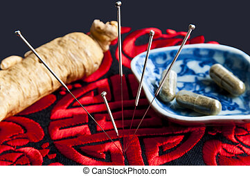 Acupuncture needles, ginseng root and herbal pills