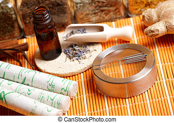 Acupuncture needles, moxa sticks and lavender petals -...