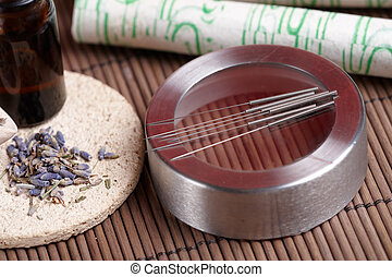 Acupuncture needles, moxa sticks and lavender petals