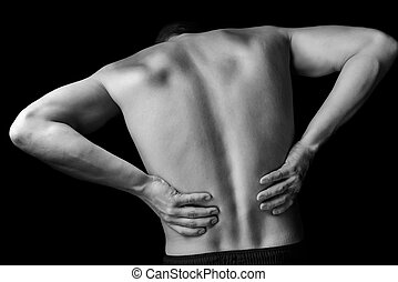 Acute pain in a male lower back, monochrome image