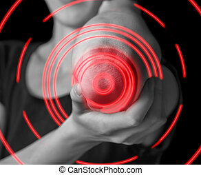 Acute pain in elbow joint - Woman holds her elbow joint,...