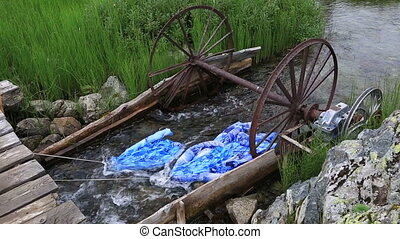 Adaptation for washing linen in a mountain river. Republic...