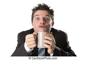 addict businessman in suit and tie holding cup of coffee as maniac in caffeine addiction