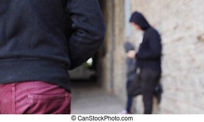 addict buying dose from drug dealer on street 20 - drug...