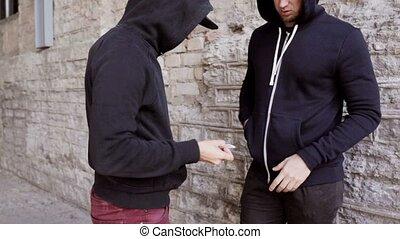 addict buying dose from drug dealer on street - drug...