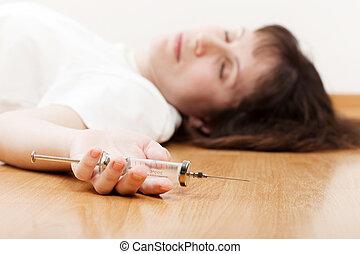 Addict injecting syringe