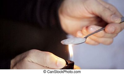 addict preparing dose of crack cocaine drug 34 - drug use,...