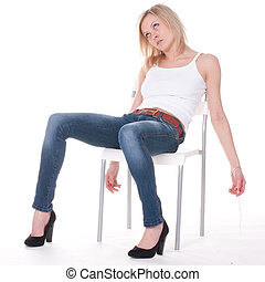 addict woman sits unconscious on the chaire
