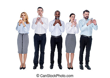 Addicted colleagues standing in one line with their phones