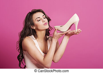 Addicted from high heels woman kissing her new shoes