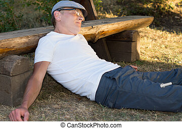 Addicted man lying down feeling sick after taking an...